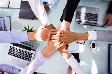 Group Of Businesspeople Stacking Hands © Andrey Popov