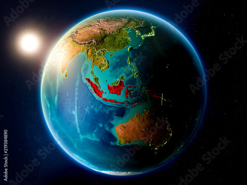 Fototapeta Indonesia with sunset from space