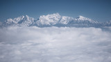 The Himalayas as seen from an airplane in Nepal. Layer of clouds beneath the mountain tops. - 219392606