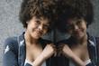 Beautiful afro hair woman looking at camera.