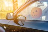 Halloween. Pumpkin in the car on the driver's seat Harvest pumpkin.