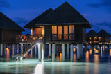Luxury water villa sunset in Maldives - 219422079