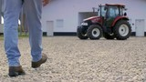 Low section of farmer walking on the farm - 219423256