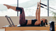 Woman doing pilates workout at the gym