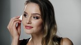 Beauty Makeup. Woman Applying Face Cosmetic With Sponge - 219456849