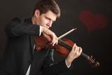 Man man dressed elegantly playing violin - 219459426