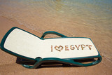 On the beach. Chaise longue with an inscription laid out in multicolored pebbles. I love Egypt. - 219462221