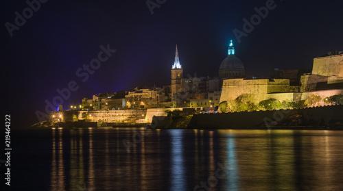Leinwanddruck Bild A city at night - Valletta, Malta