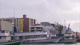 Boats docked in coastal city, Maldives - 219467446