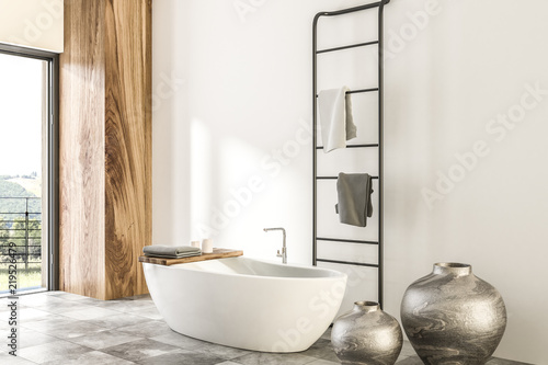 Leinwanddruck Bild Marble and wooden bathroom corner, white tub