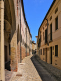 A cloistered pavement in a shopping area of Treviso Italy - 219583200
