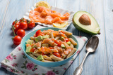 cold pasta with smoked salmo avocados and tomatoes - 219587692