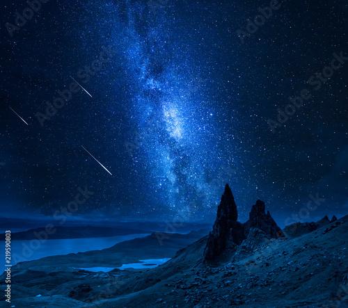 Leinwandbild Motiv Falling stars over Old Man of Storr at night, Scotland