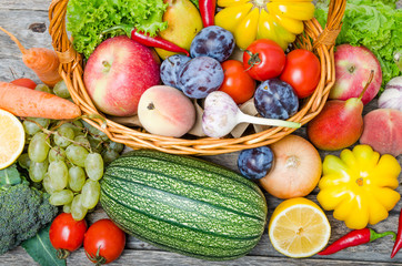 Fruits and vegetables in the basket top view.