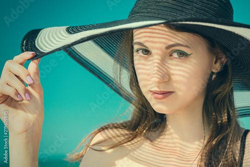 Foto Murales woman in hat