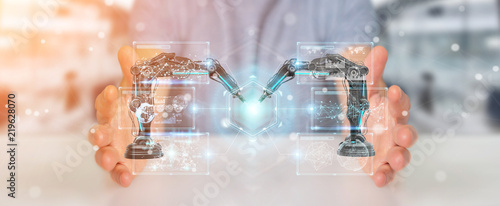 Leinwanddruck Bild Businessman using robotics arms with digital screen 3D rendering