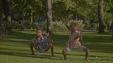 Positive african american little sisters in casual clothes dancing hip hop on green grass lawn in summer park. Lovely preteen dancers performing dance moves in nature. Slow motion. - 219635429