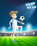 A football player at the stadium - 219636003