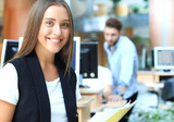 Business woman with her staff, people group in background at modern bright office. - 219637660