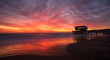 Vivid colours of the sunrise at Durban's South Beach, Durban, South Africa