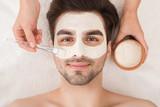 Man having cosmetic mask in spa salon - 219645053