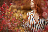 Autumn woman in autumn scene Warm sunny weather. Fall concept - 219645878