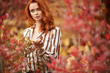 Autumn woman in autumn scene Warm sunny weather. Fall concept - 219645896