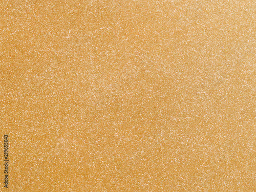 Shiny hot yellow gold foil golden color glitter decorative texture paper: Bright brilliant festive metallic textured empty wallpaper backdrop: Tin metal material for holiday craft design decoration