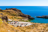 Sea view and parking for cars in the village of Lindos on the island of Rhodes - 219655468