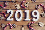 New year 2019 word and Christmas decoration on wooden table. Business concept. - 219681209