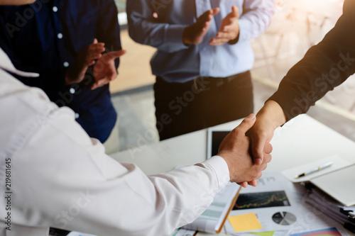 Closeup Business partnership meeting concept. Image businessmans handshake. Successful businessmen handshaking after good deal.