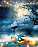 Spooky halloween pumpkin on wooden planks - 219683258