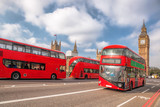 Big Ben with red buses in London, England, UK - 219688873