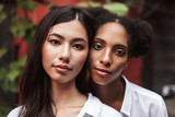 Portrait of beautiful girls in white shirts dreamily looking in camera - 219691040