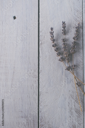 Lavender in white rustic wooden desk. Toned photo. Space for text.