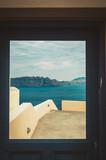 Window with view of Thira and caldera of Santorini volcano - 219702418