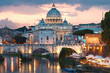 Night view to Ponte Sant'Angelo and Vaticano in Rome, Italy