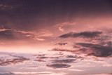 Beautiful pink red colored sky with sunset light and clouds. - 219708233