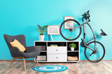Stylish room interior with bicycle and armchair