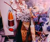 Movable vintage flower shop. Mobile car store on wheels