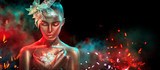 Fashion model woman in colorful bright golden sparkles and neon lights posing with fantasy flower. Portrait of beautiful girl with glowing makeup - 219716020