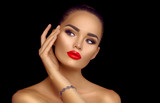 Beauty brunette woman with professional holiday makeup. Beautiful girl's face isolated on black background - 219716427