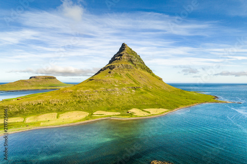 Leinwanddruck Bild Aerial drone view of Iceland nature Kirkjufell mountain landscape in West Iceland on the Snaefellsnes peninsula. Icon of Iceland travel and most photographed icelandic mountain. Top shot from above.