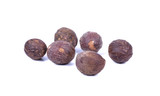 Thai herb name Myristica fragrans Houtt. or Nutmeg seeds isolated on white background - 219726804