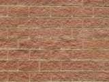 Wall from pink stone blocks, background