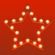 Red star with shiny light bulbs