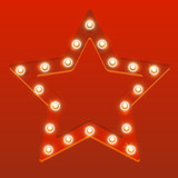 Red star with shiny light bulbs - 219742431