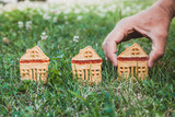 Cookies in shape of  small house stand on green grass