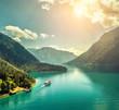 Leinwanddruck Bild - Beautiful morning sunrise view on the mountain lake in Alps