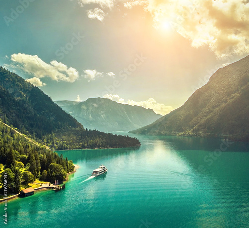 Leinwanddruck Bild Beautiful morning sunrise view on the mountain lake in Alps